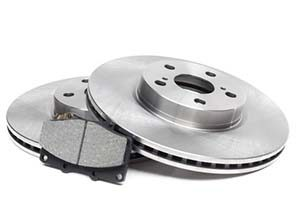 brake discs and brake pads on a white background. car parts